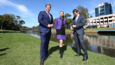 New home: Arts Minister Troy Grant, MAAS director Dolla Merrillees and NSW Premier Mike Baird opposite the proposed site in Parramatta for the Powerhouse Museum.
