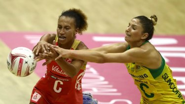 Arch-rivals: Australia's Kim Ravaillion battles England's Serena Guthrie in London.