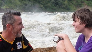 Sam and his dad James by the Nile in Africa.
