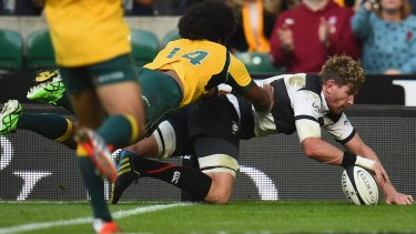 Queensland-bound flanker Adam Thomson scores in the corner for the Barbarians.