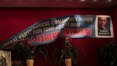 A poster falls at a Chinese Liberal party fundraising dinner in Sydney in 2010.