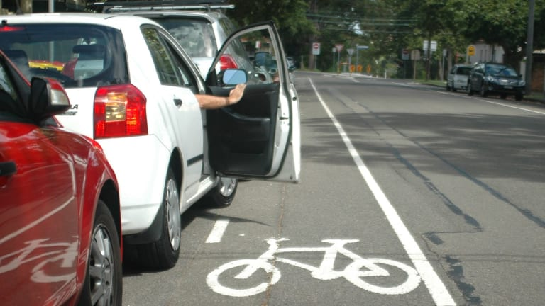 Door danger: riding too close to parked cars can be hazardous.