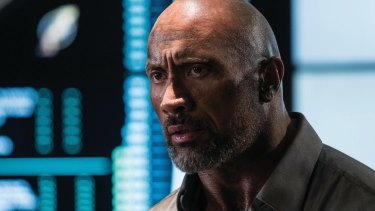 In <I>Skyscraper</I> Dwayne Johnson rarely seems confident of being able to get out alive.