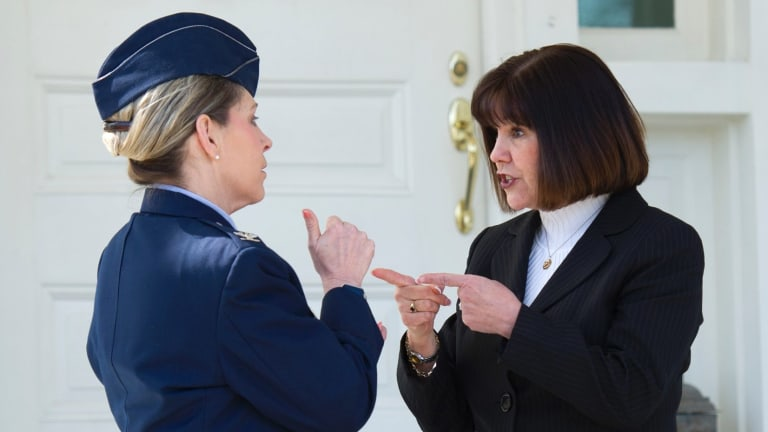 Karen Pence, right, talks with Air Force Colonel Michelle Pufall while welcoming female members of the military to a reception in recognition of Women's History Month.