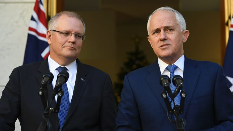 Scott Morrison and Malcolm Turnbull announce the royal commission, a sharp U-turn from their previous refusal to consider it.