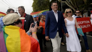 The Victorian Premier Daniel Andrews, with his wife Catherine, at the annual Pride March in St Kilda in 2015. The Premier will issue an apology on May 24, 2016, for laws that once criminalised homosexuality.