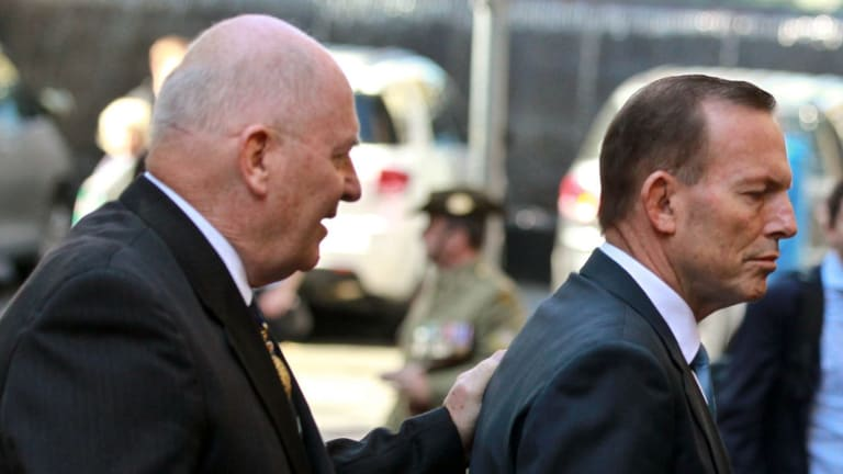 How it should have been: Governor-General Sir Peter Cosgrove showing former prime minister Tony Abbott the way out.