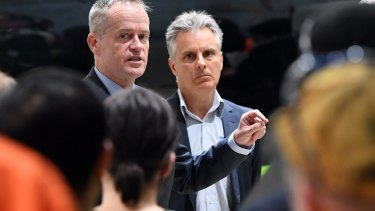 Bill Shorten (left) at Socobell original equipment manufacturer (OEM) alongside the company's managing director Ross Bellesis in Melbourne on Monday.
