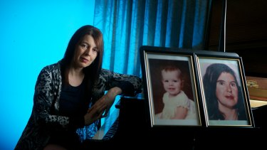 Melissiah Faulkner with photos of her missing younger sister Charmian and mother Louise.