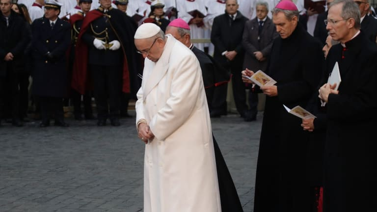 Pope Francis prays in front of the statue of the Virgin Mary, near Rome's Spanish Steps .