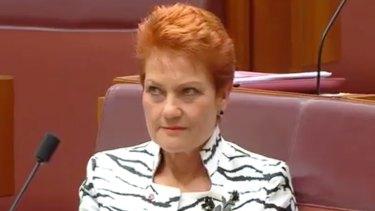 Pauline Hanson rolls her eyes during the maiden speech by One Nation Senator Malcolm Roberts.