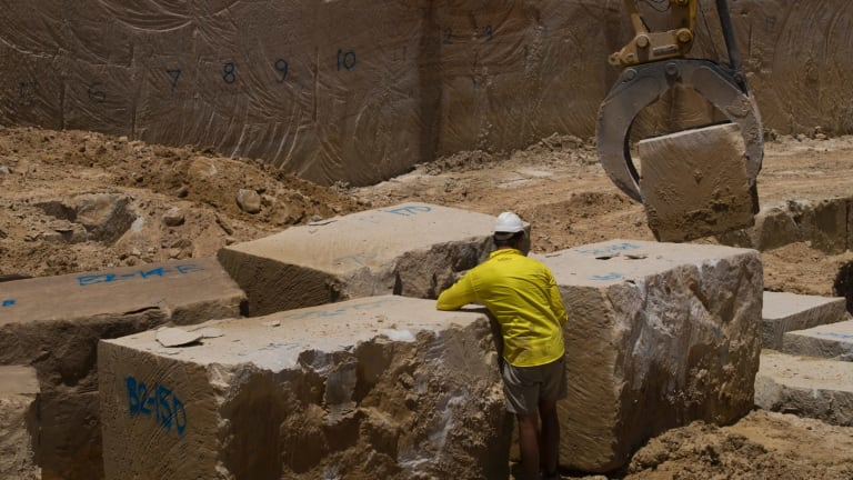 Workers at the Bundanoon Sandstone quarry in Harris Street, Pyrmont. The yellow block sandstone will be used to restore some of the city's most important heritage buildings.