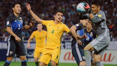 Contained: Tim Cahill can't find any joy in front of goal.