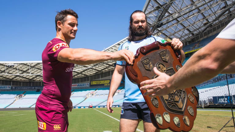 Hand it over: Queensland's Cooper Cronk and the Blues Aaron Woods both want that Origin shield.