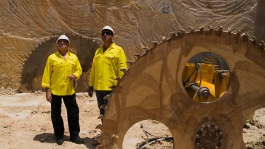 A massive saw is used to cut the sandstone into blocks before they are extracted and transported out of the quarry.