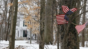 Small American flags fly in front of the Warmbier family home in Wyoming, Ohio, after Otto Warmbier's detention in January.