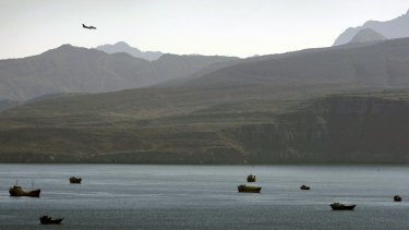 A plane flies over the mountains south of the Strait of Hormuz in 2012.