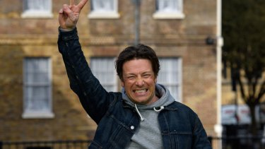 Jamie Oliver celebrates after the announcement of a tax on sugary soft drinks in Britain. Will Australia follow?