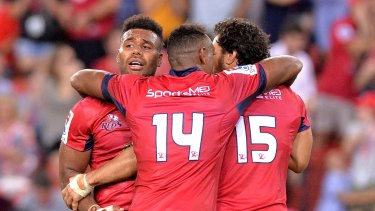 Winning start: (from left) Samu Kerevi, Chris Kuridrani and Karmichael Hunt celebrate victory over the Sharks on Friday night.