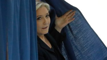 Far-right leader and candidate for the 2017 French presidential election Marine Le Pen exits a polling booth.