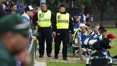 Precautions: Security guards Tonga Koli (left) and Itilani Latu from E Group security patrolling the Penrith and districts Junior Rugby League matches.
