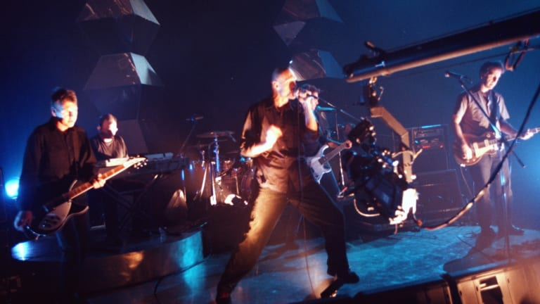 Midnight Oil performing live.