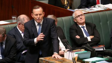 Communications Minister Malcolm Turnbull listens as Prime Minister Tony Abbott responds to a question on cabinet leaks during Question Time at Parliament House in Canberra on Wednesday 3 June 2015.