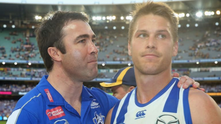 North Melbourne coach Brad Scott with skipper Andrew Swallow.