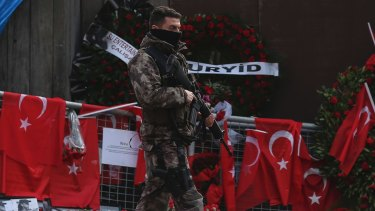 A Turkish special security force member patrols near the scene of the nightclub attack.