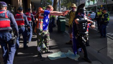 Police and protesters parodying the far-right were outside court on Monday.