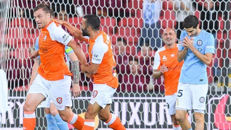 Roar's Avram Papadopoulos (left) celebrates after scoring against Melbourne City at Suncorp Stadium in Brisbane.
