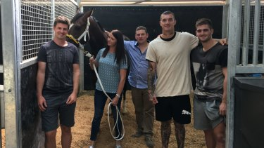 Team bonding: Andrew McQualter, Natalie Young (trainer), Trent Busuttin (trainer), Dustin Martin and Anthony Miles with Victoria Derby favourite Main Stage.