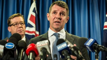 Mike Baird is flanked by Deputy Premier Troy Grant as he announces the greyhound racing ban backdown in October.