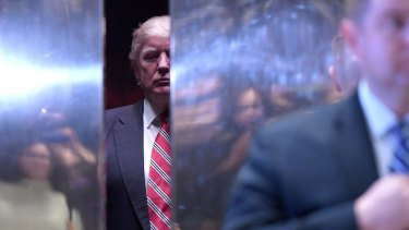 US President-elect Donald Trump in an elevator in the lobby of Trump Tower.