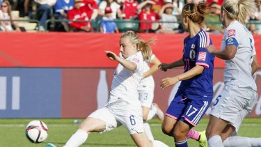 England defender Laura Bassett (6) tries to block a pass during the second half of a Women's World Cup semifinal against Japan in Edmonton, Canada, on July 1, 2015. The ball looped and went in off the underside of the bar, providing Japan a 2-1 victory. Japan will meet the United States in the final for the second tournament in a row. (Kyodo) ==Kyodo England defender Laura Bassett (6) tries to block a pass during the second half of a Women's World Cup semifinal against Japan in Edmonton, Canada, on July 1, 2015. The ball looped and went in off the underside of the bar, providing Japan a 2-1 victory. Japan will meet the United States in the final for the second tournament in a row. (Kyodo) ==Kyodo