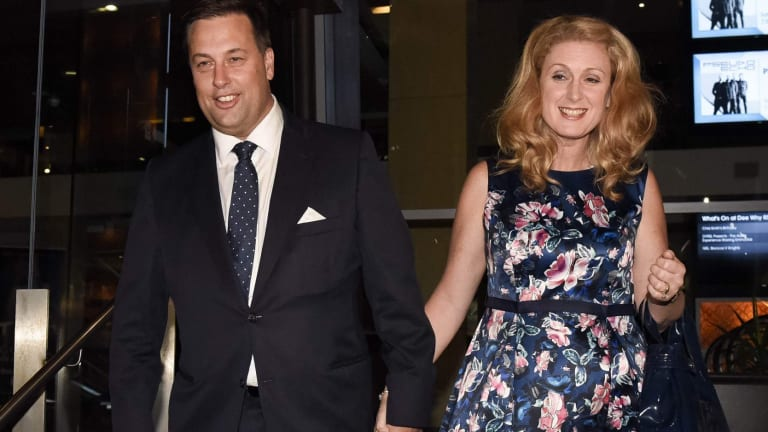 Jason Falinski leaves Dee Why RSL with his wife after defeating Bronwyn Bishop in the Liberal pre-selection ballot for the seat of Mackellar.