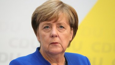 Angela Merkel, Germany's chancellor and Christian Democratic Union (CDU) leader, pauses during a news conference at the party's headquarters in Berlin, Germany.