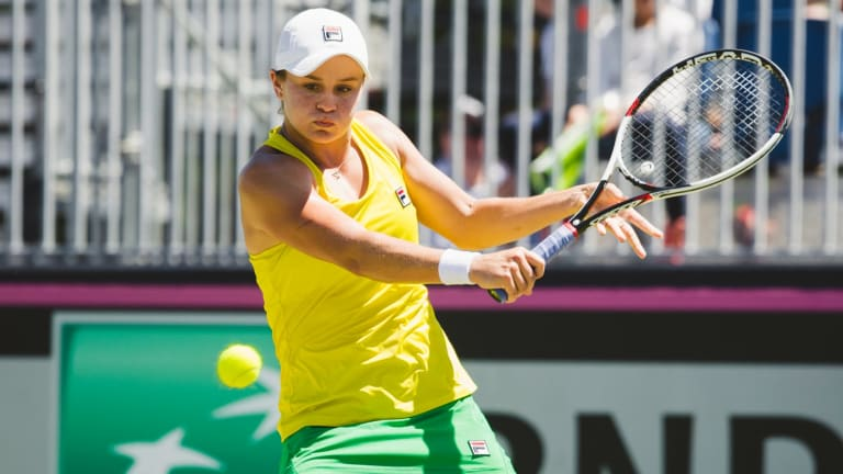 Australia's Ashleigh Barty won in three sets at the Canberra Tennis Centre.