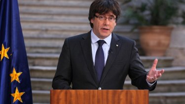 Catalan President Carles Puigdemont has called on Catalans to peacefully oppose Spain's takeover, in a staged appearance that seemed to convey that he refuses to accept his firing, which was ordered by central authorities.