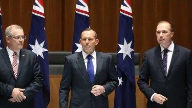 Joke under fire: Peter Dutton, right, with Tony Abbott and Scott Morrison.