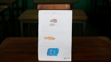 """A drawing made during a lesson at a school shows what a Caracas student ate during the course of a day: """"For breakfast, lunch and dinner I had corn cake with cheese."""""""