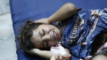 A Palestinian child, wounded in the Israeli strike on a UN school in Gaza.