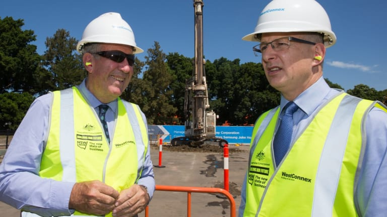Federal Minister for Major Projects Paul Fletcher, right, said the government was already looking at a system of road pricing for heavy vehicles.
