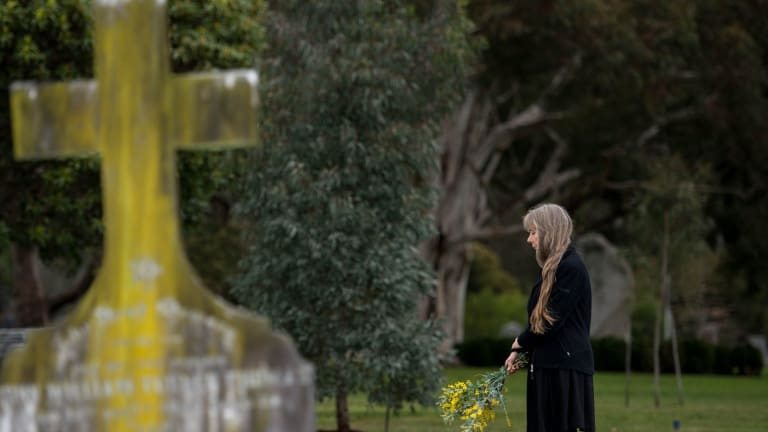 Lucy Sussex at the unmarked grave of writer Mary Fortune at the Springvale Cemetery.