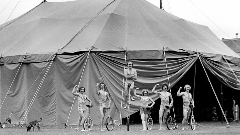 Circus Oz members, including Tim Coldwell on high, in front of their home-made tent in 1978.