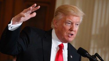 President Donald Trump won't halt Australia's refugee deal, PM says.