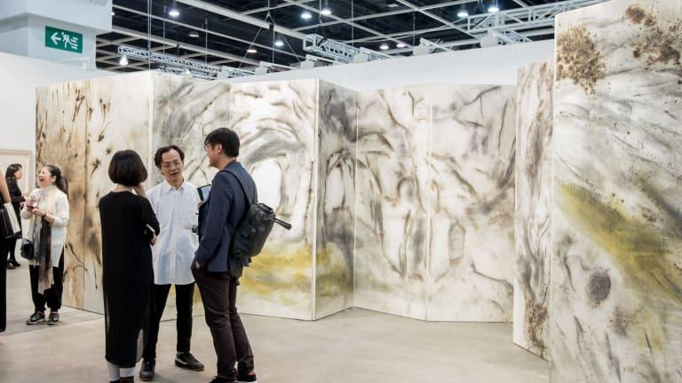 Cai Guo-Qiang's <i>Taroko Gorge</i>,  gunpowder on paper, mounted on wood as an 18-panel folding screen.