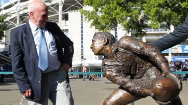 Solid status: Ken Catchpole stands with a bronze statue of his likeness outside the SFS in honor as one of the greatest Wallaby Test players ever.