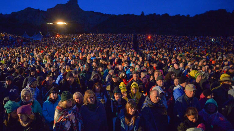 More than 10,000 people packed Anzac Cove for the dawn service.
