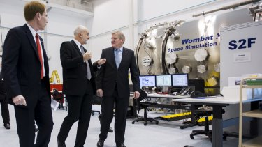 ANU Vice-Chancellor Professor Ian Young, Director of the Research School of Astronomy Professor Matthew Colless, and Minister for Industry Ian Macfarlane at the unveiling of the space engineering facility at the ANU at Mount Stromlo.